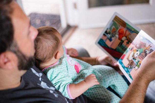 Dad Reading Book to Baby