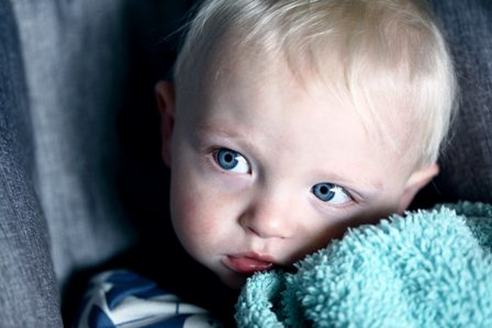 Anxious Toddler Clutching Blanket